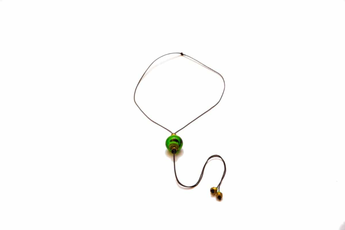 """Green Beat"" Necklace Shop by Venezia Autentica - Shop by Venezia Autentica - Sleek necklace with a beautiful green Murano Glass pendant, designed and handmade in Venice, Italy. The pendant, crafted by lampworking, is unique and durable."