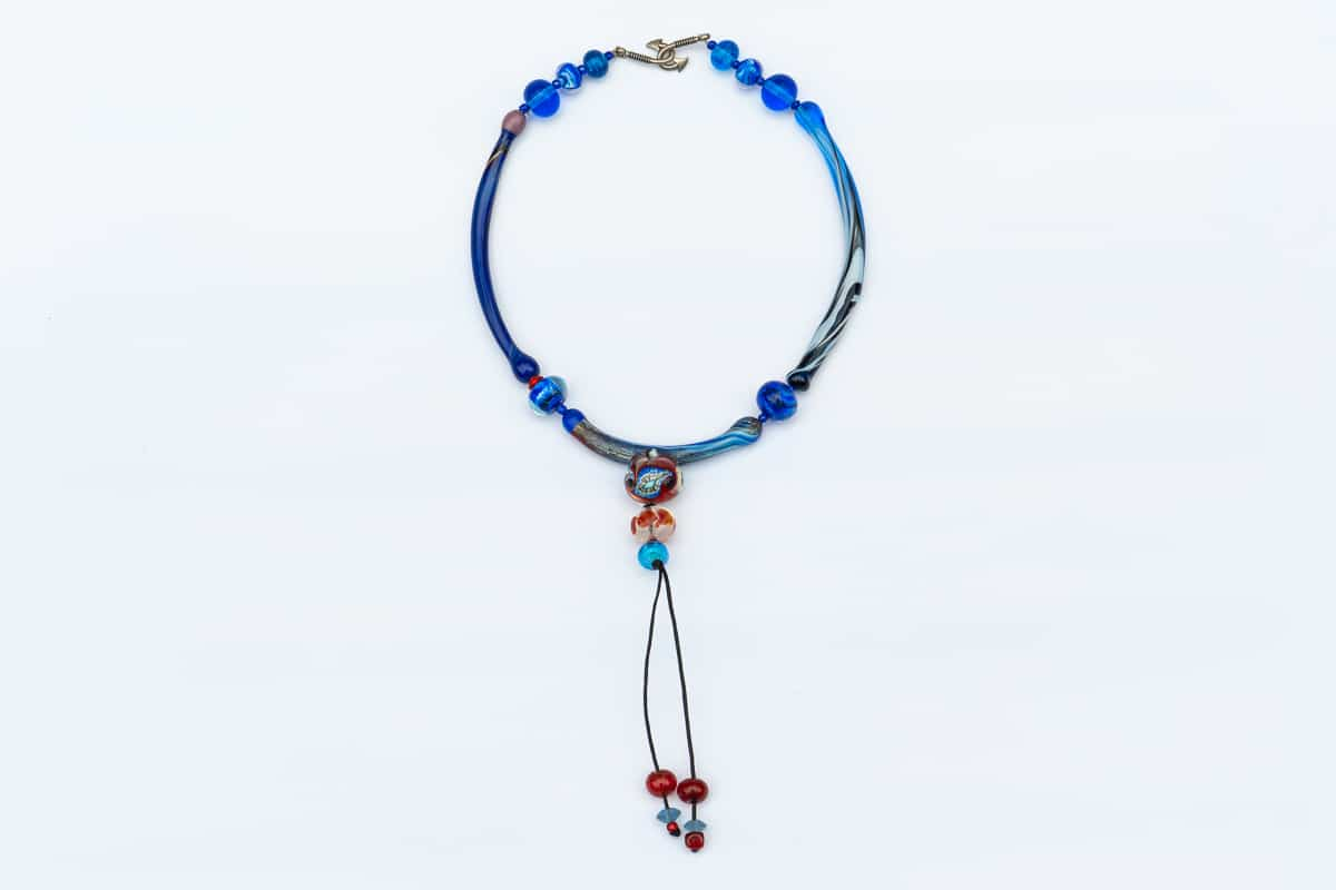 """Red and Blue Spell"" Necklace Shop by Venezia Autentica - Shop by Venezia Autentica - Eye-catching blue and red Murano Glass necklace, designed and handmade in Venice, Italy. Beware, its unique colors and shapes make anyone fall in love with it!"